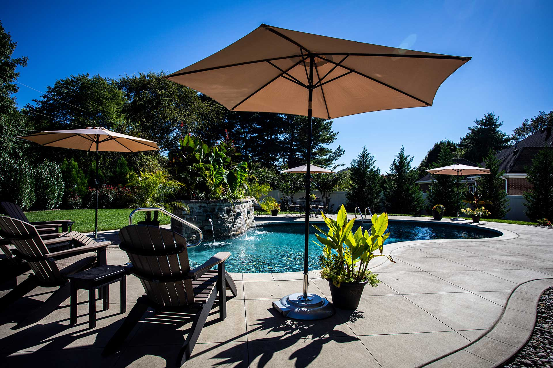 In Ground Pool with Umbrellas and Plants